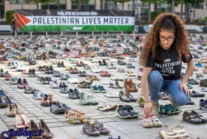 عکس) + هزاران جفت کفش برابر مقر اتحادیه اروپا چیده شد (